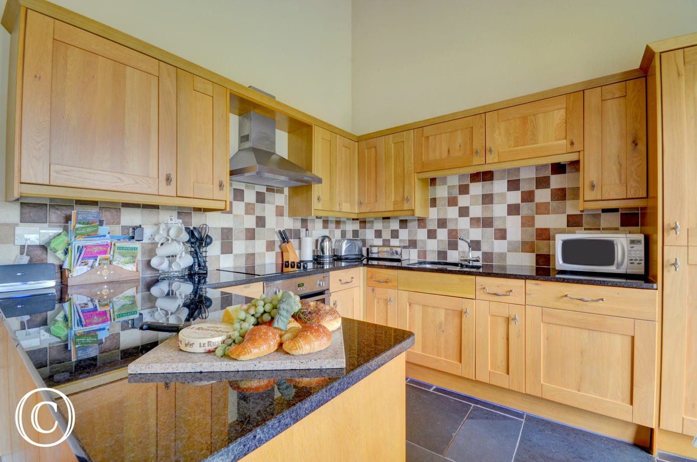 Country style kitchen with oak units, slate floor and well equipped for all your needs