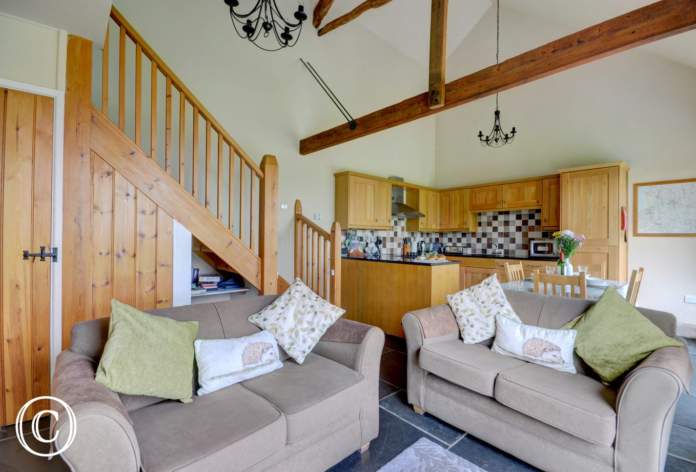 So much character has been kept in this wonderful open plan living area