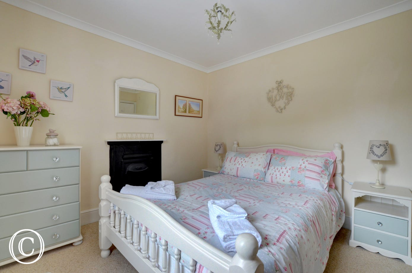 Very pretty double bedroom with feature fireplace