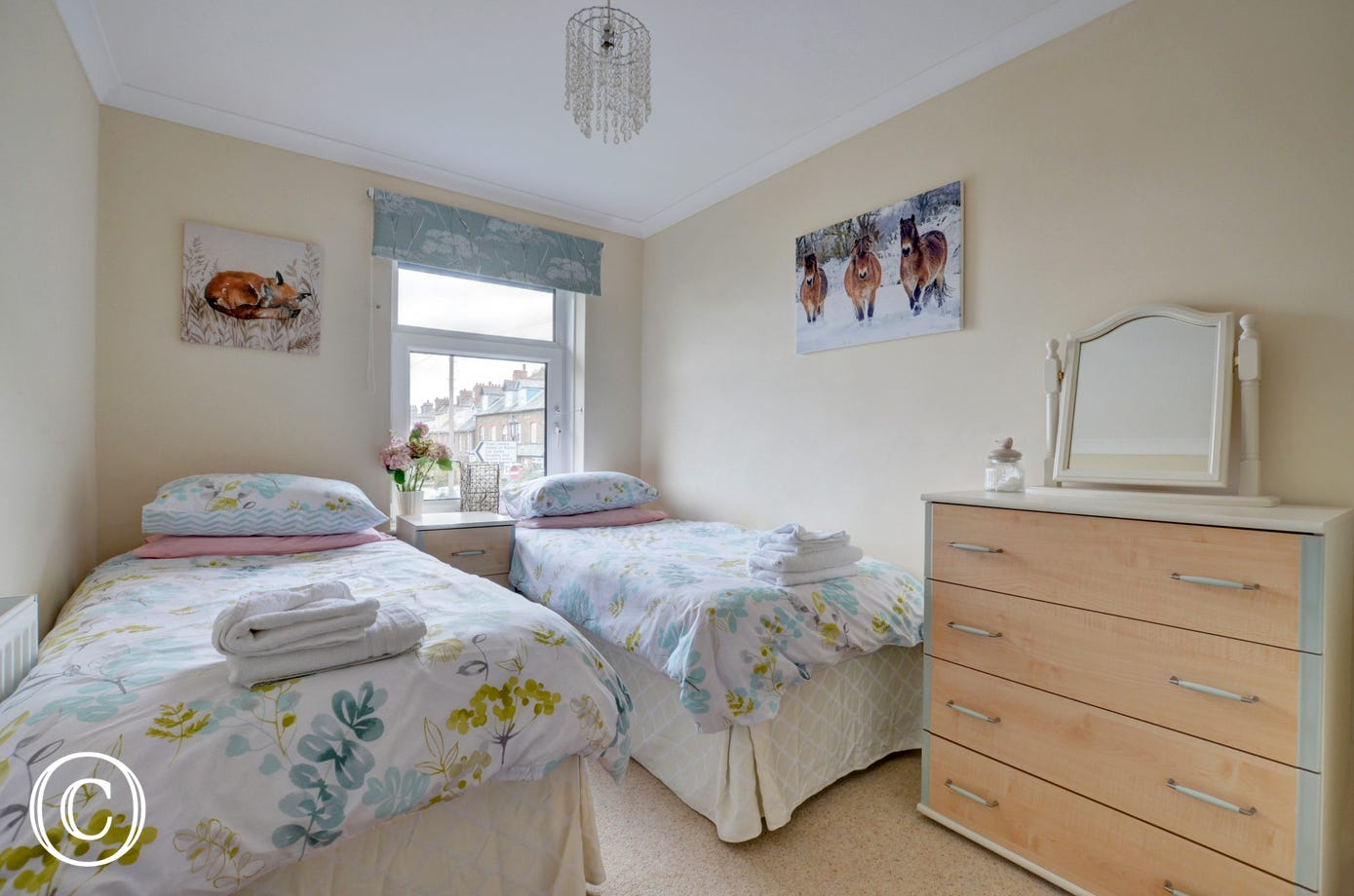 The third bedroom has twin beds, great for children or adults