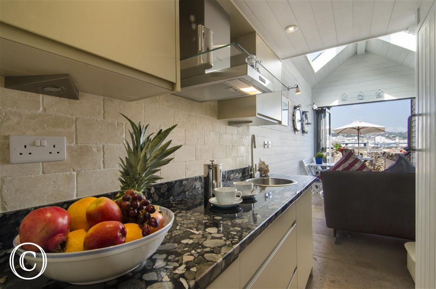 Luxury granite kitchen surfaces with 2 ring induction hob
