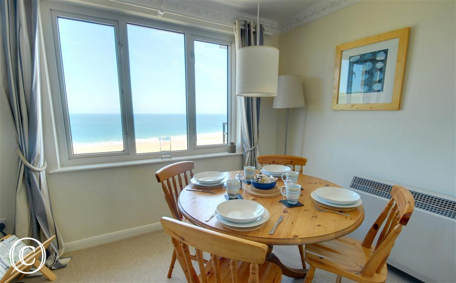The dining table has been strategically positioned so you can enjoy the views whilst having a meal!