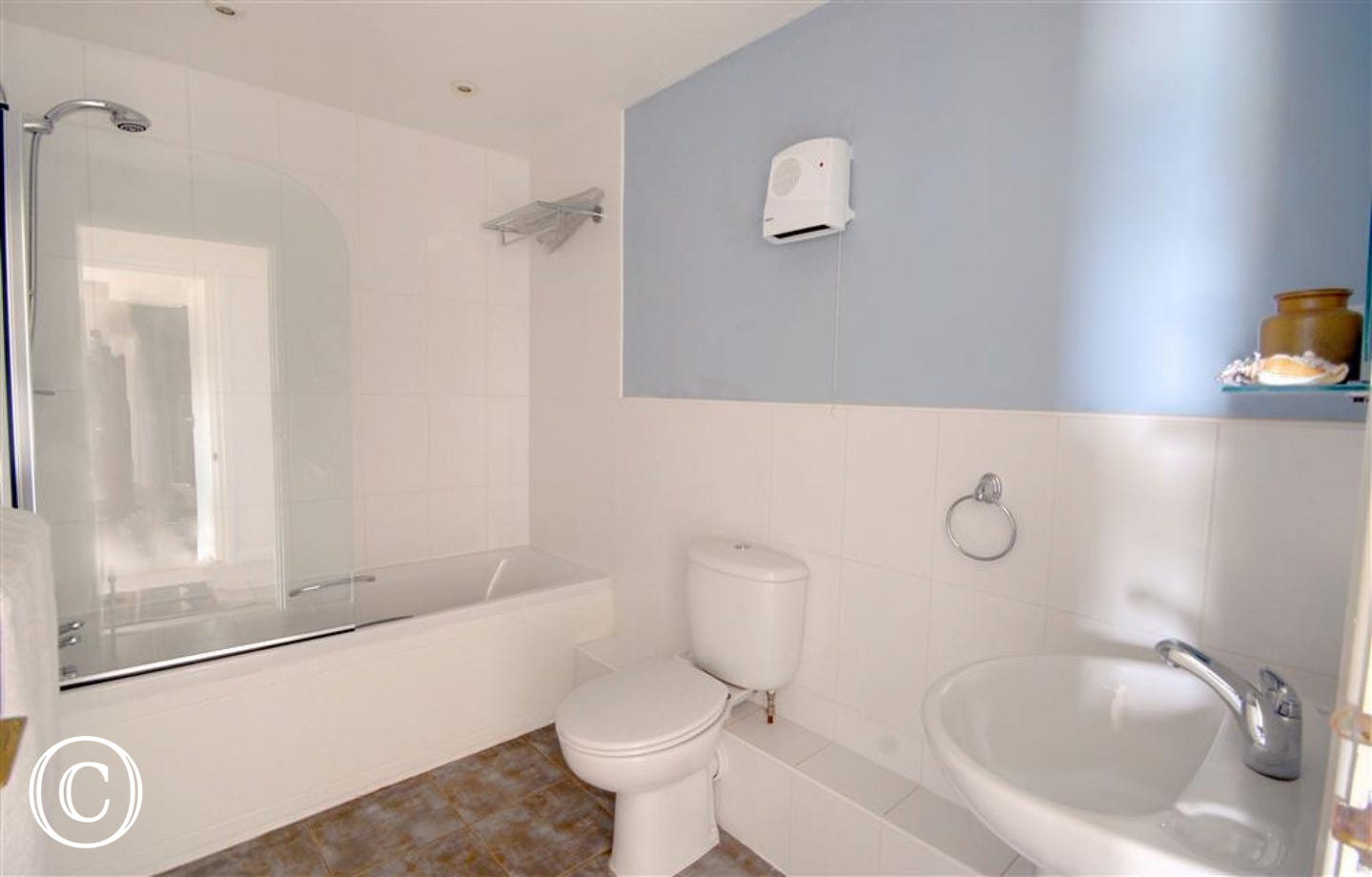 The separate bathroom serves the Twin bedroom.