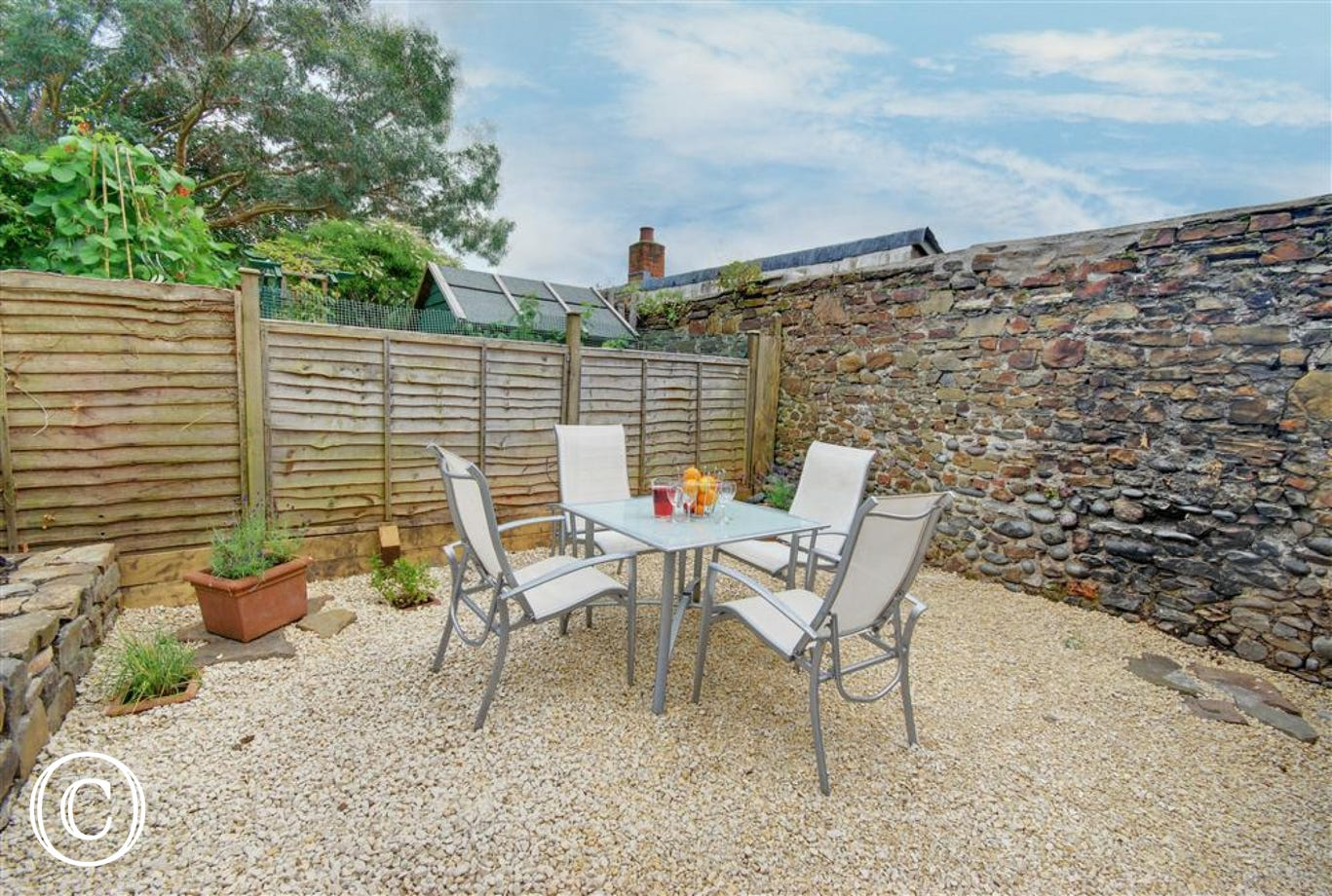 Relax with friends and family in this sun trap and enjoy al fresco dining