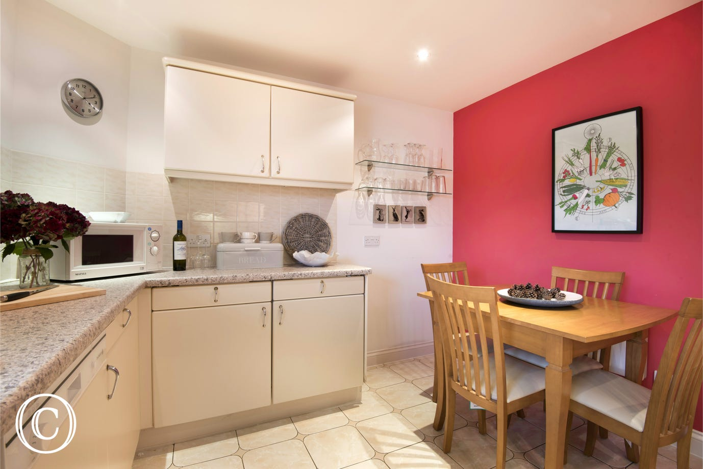 homely well-equipped kitchen with dining area