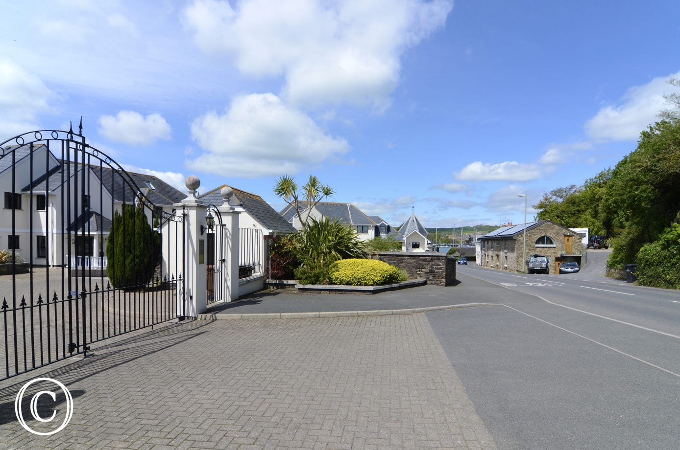 Secure gated entrance to self-catering apartments in Kingsbridge with private parking and estuary views