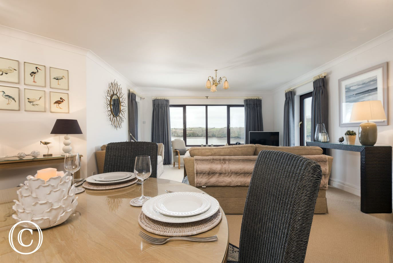 open plan living and dining area, bright and spacious with modern stylish furnishings