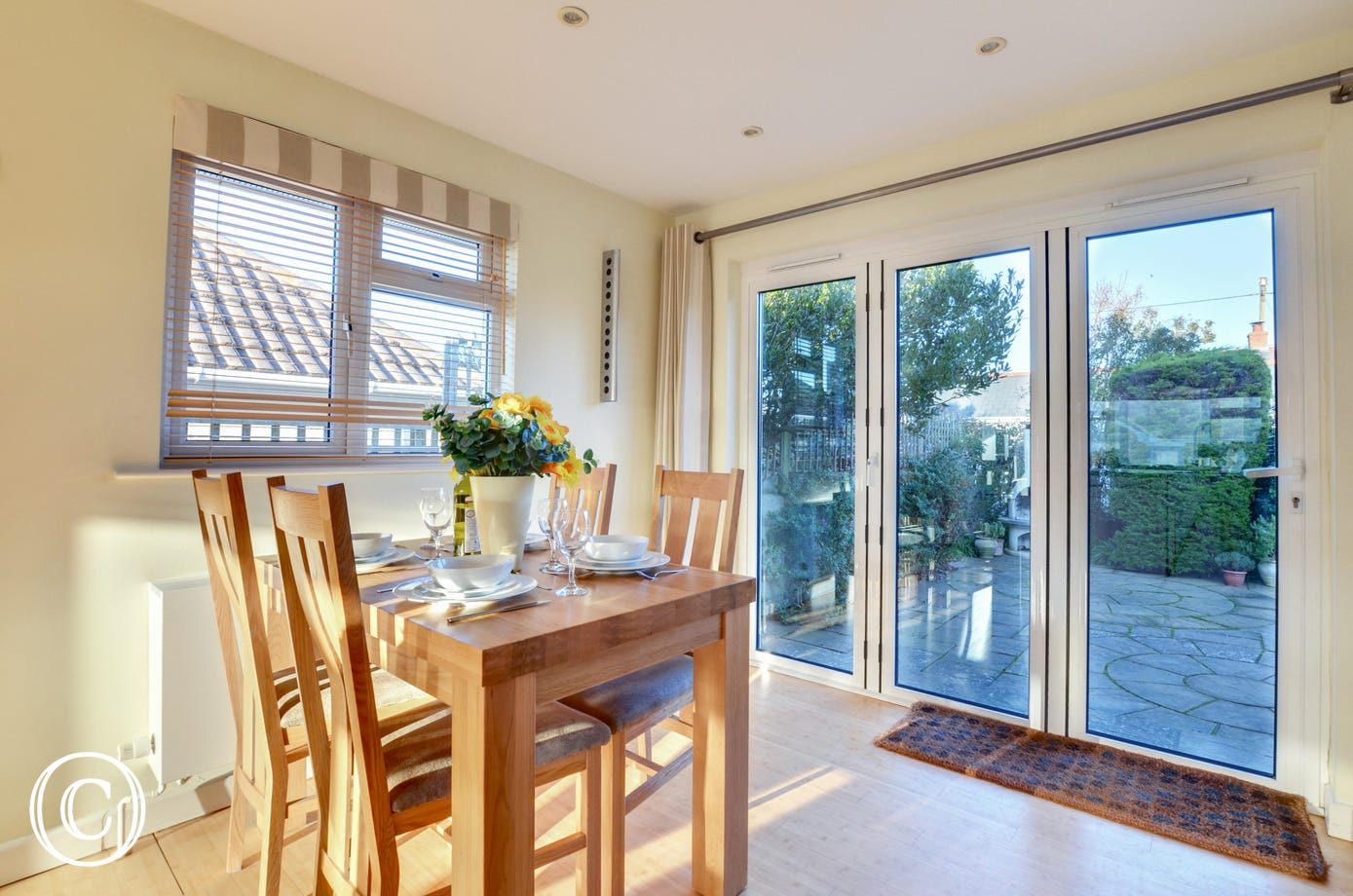 Light and bright dining area with patio doors to the garden