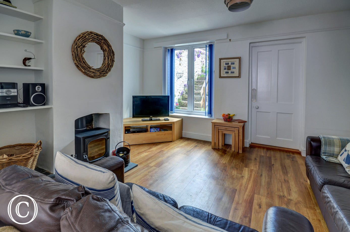 Comfortable sitting room with cosy woodburner