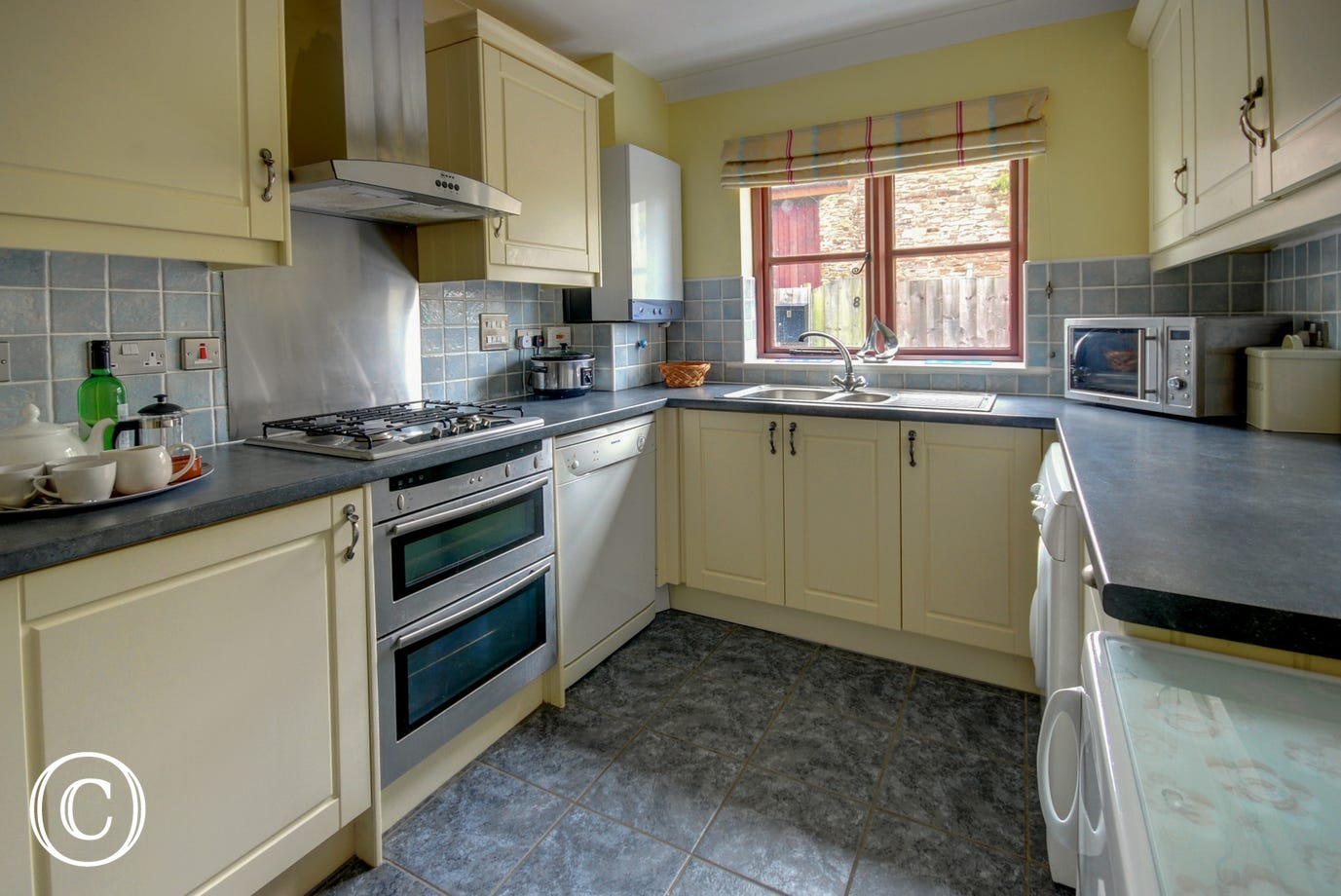 The kitchen has plenty of space to prepare meals and is well equipped