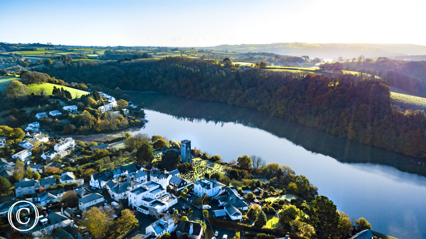 aerial shot over Stoke Gabriel village and the river Dart
