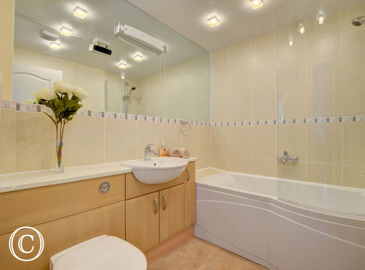The master bedroom benefits from an ensuite bathroom