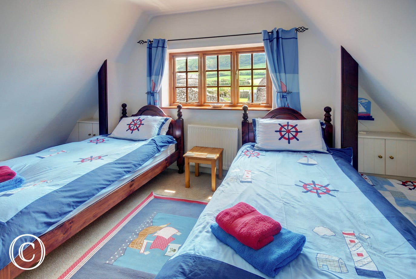 The cosy twin bedroom on the first floor with lovely views