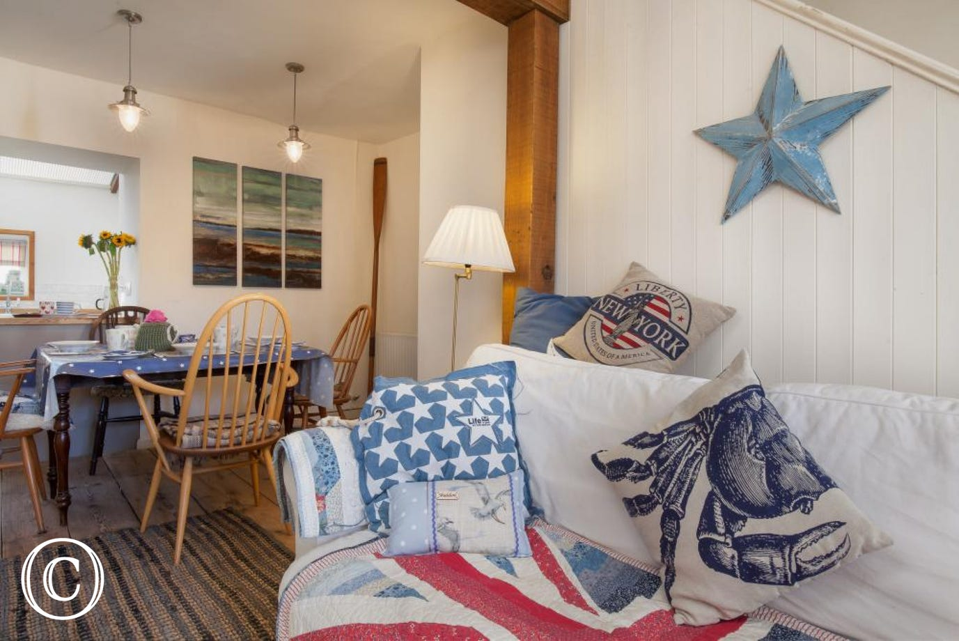 Star Cottage, Shaldon - Living area with sofa and dining table in the background