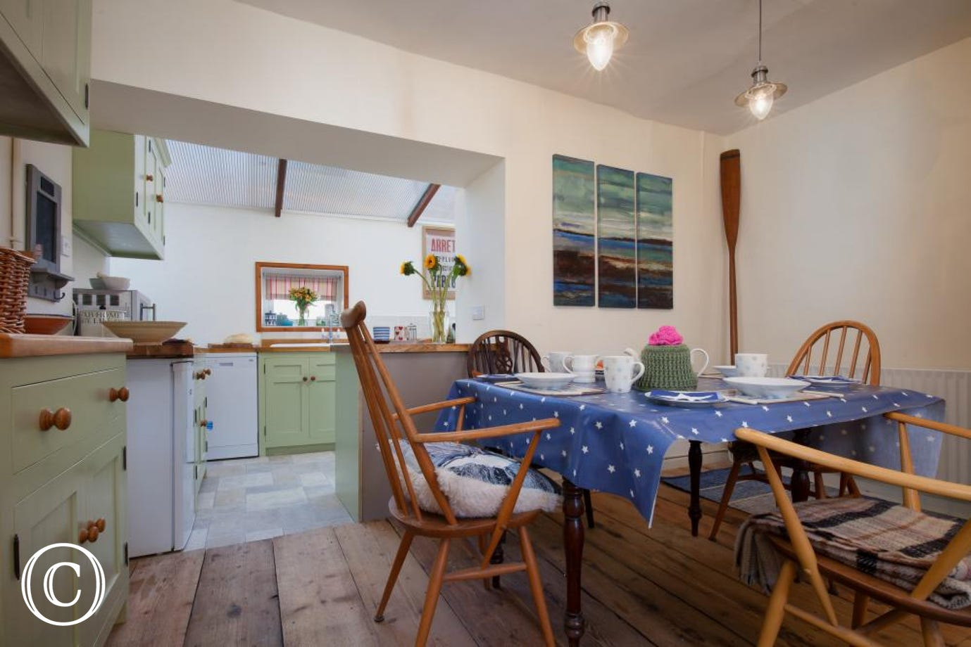 Star Cottage, Shaldon - Dining table and kitchen area