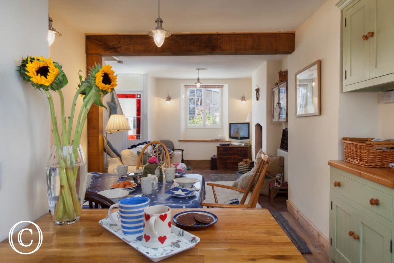 Star Cottage, Shaldon - View of living room and dining table from the kitchen