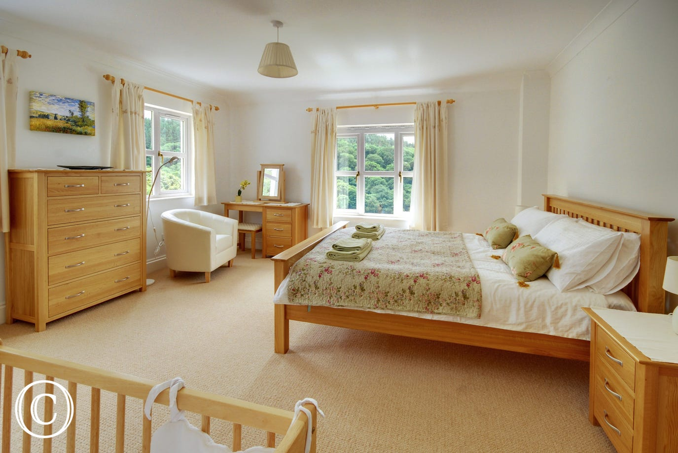 Beautiful dual aspect master bedroom with wooden cot