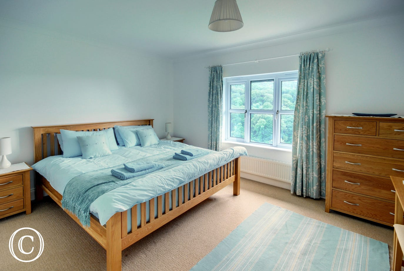 Brightly decorated bedroom with lovely views