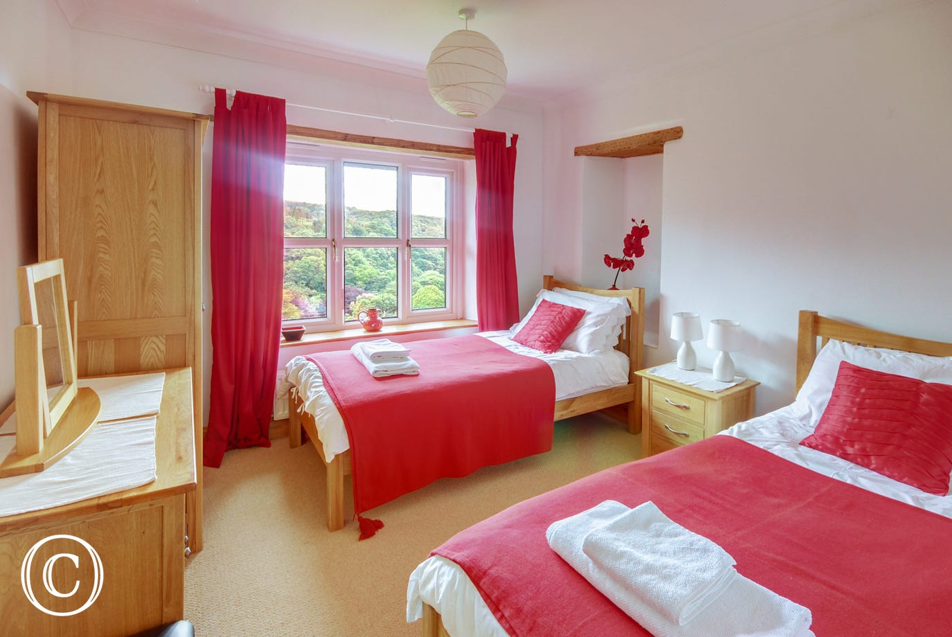 The twin bedroom is bright and cheerful with lovely views