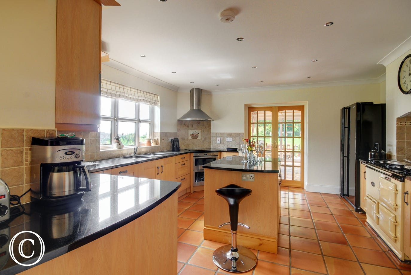 The kitchen is beautifully fitted in light oak complemented by polished granite worktops and terracotta stone tiled floor