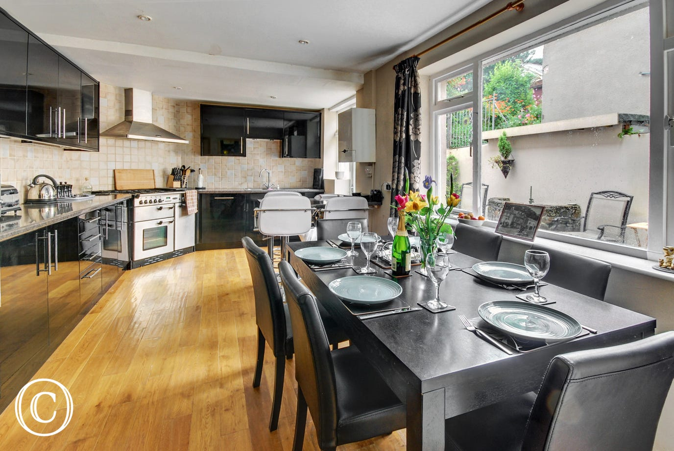 The spacious and modern kitchen/diner with a good size dining table for 6 to 8 and a breakfast bar for 4 is ideal for enjoying leisurely breakfasts or a family meals