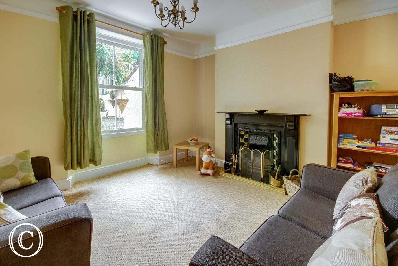 The second sitting room with large sash window