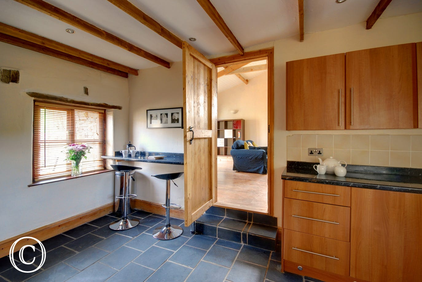 The modern kitchen is well equipped and also has a useful breakfast bar with bar stools