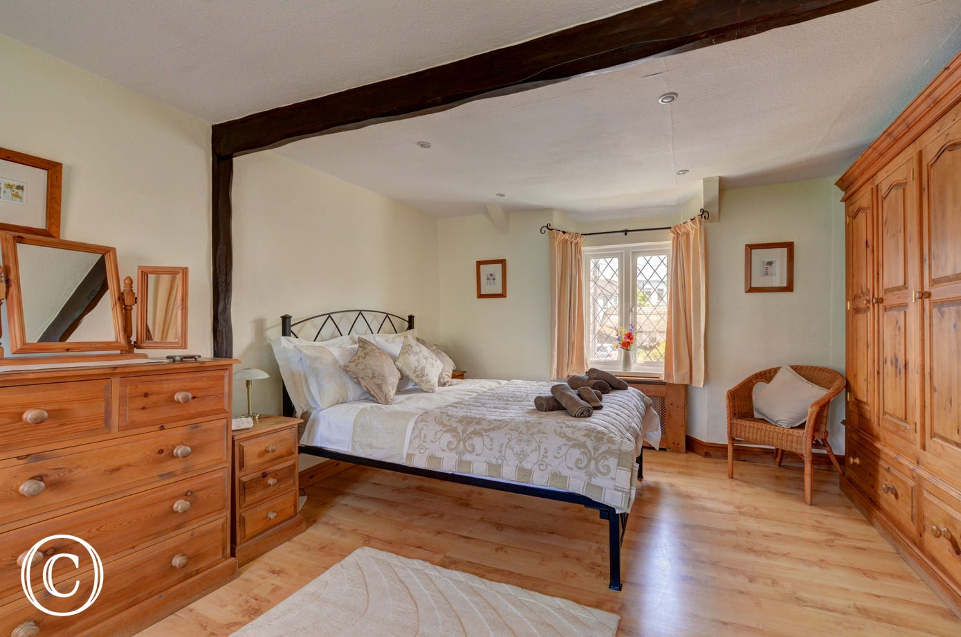 The lovely master bedroom which has plenty of storage