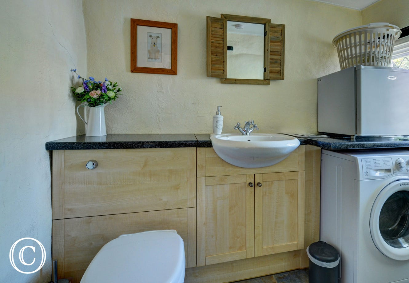 A spacious utility and cloakroom complete the ground floor