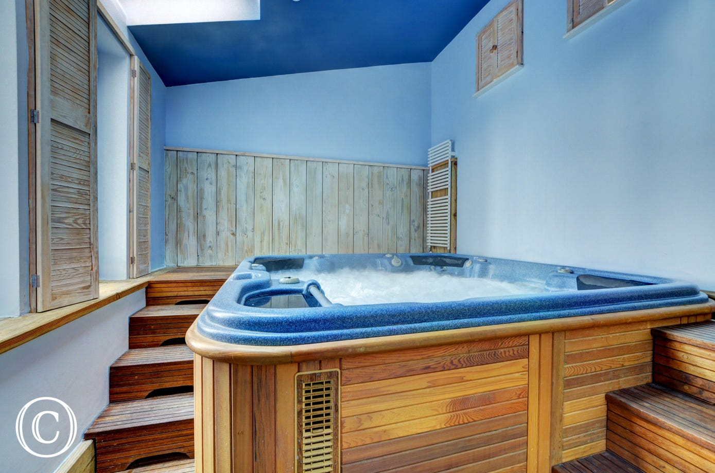 Relax in the huge hot tub after a fun filled day at the beach