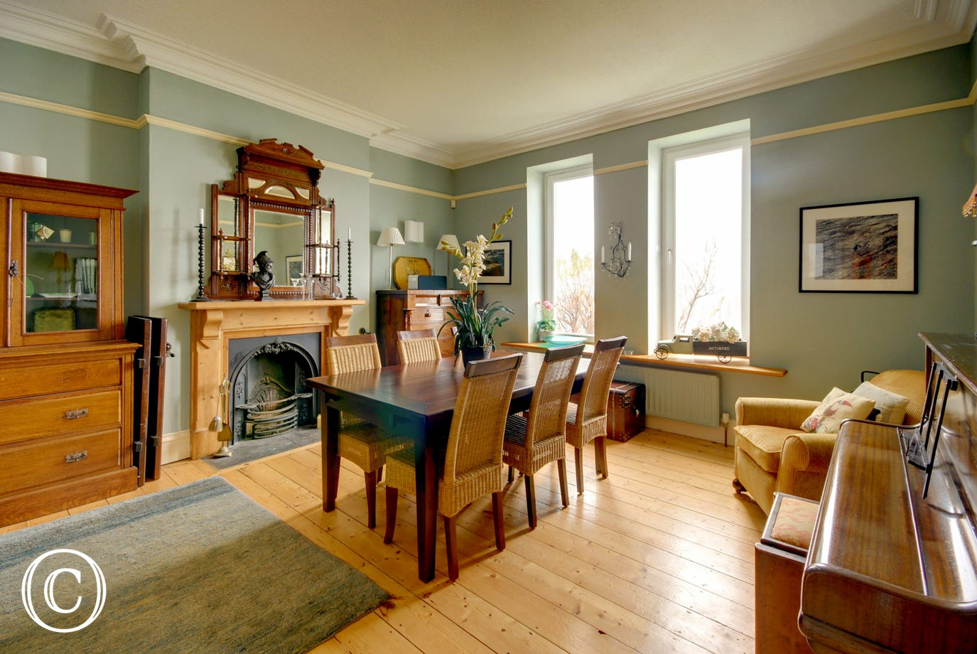 The sizeable dining room, with decorative fireplace, has double doors opening into the pretty bespoke style kitchen