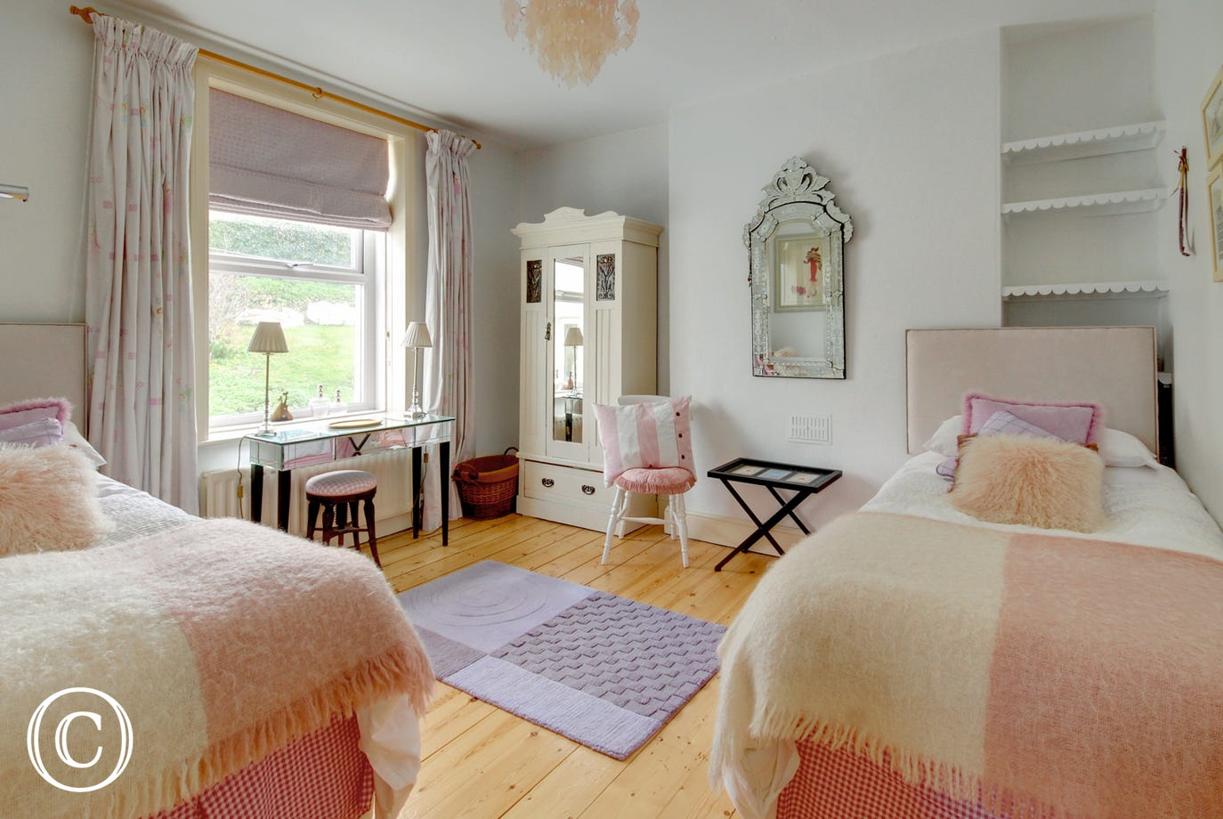 Pretty twin bedroom with garden views