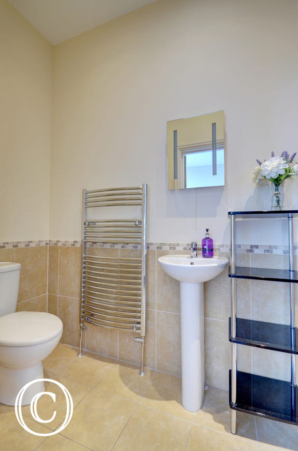 Ensuite bathroom with heated towel rail