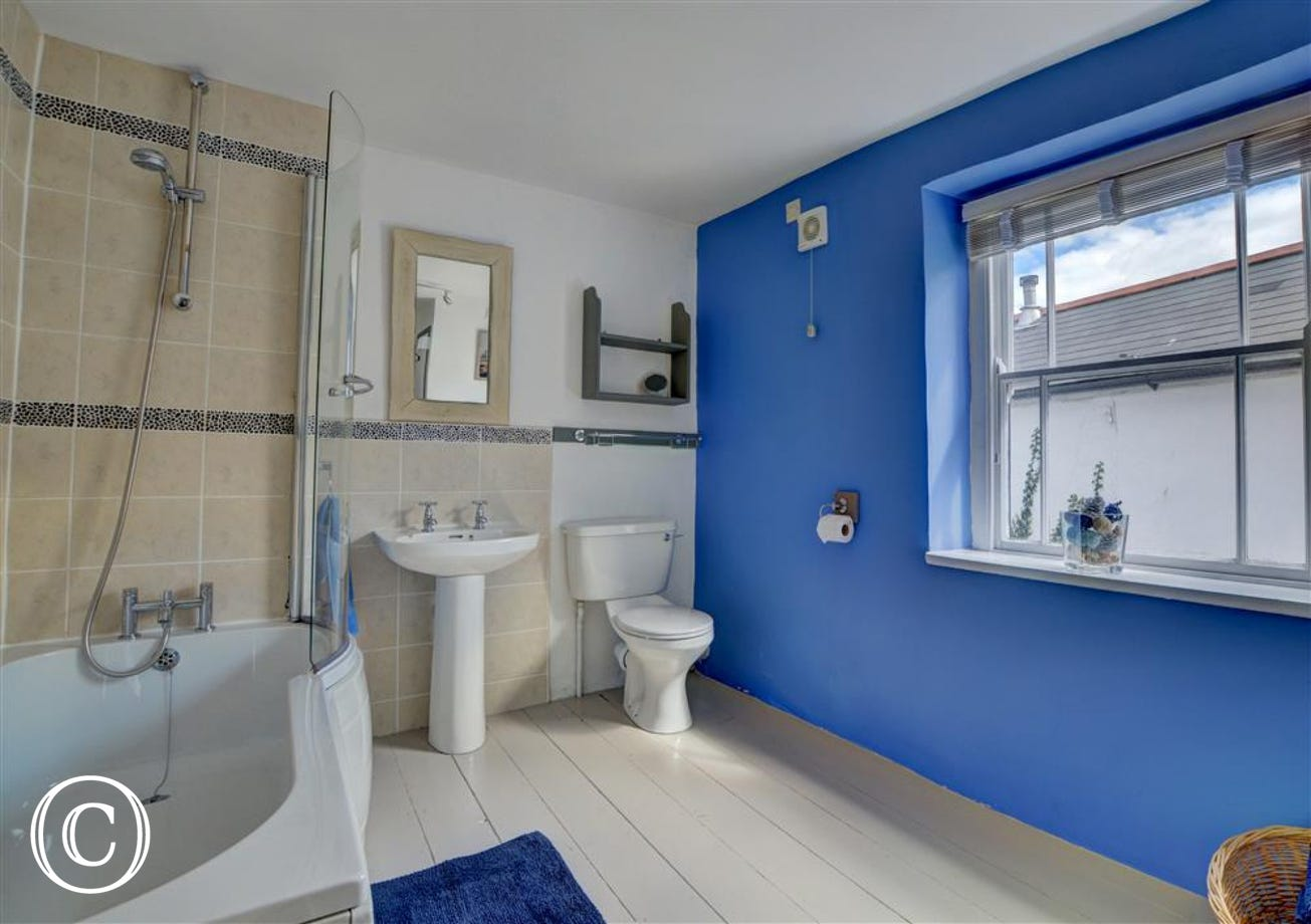 The bright and spacious family bathroom