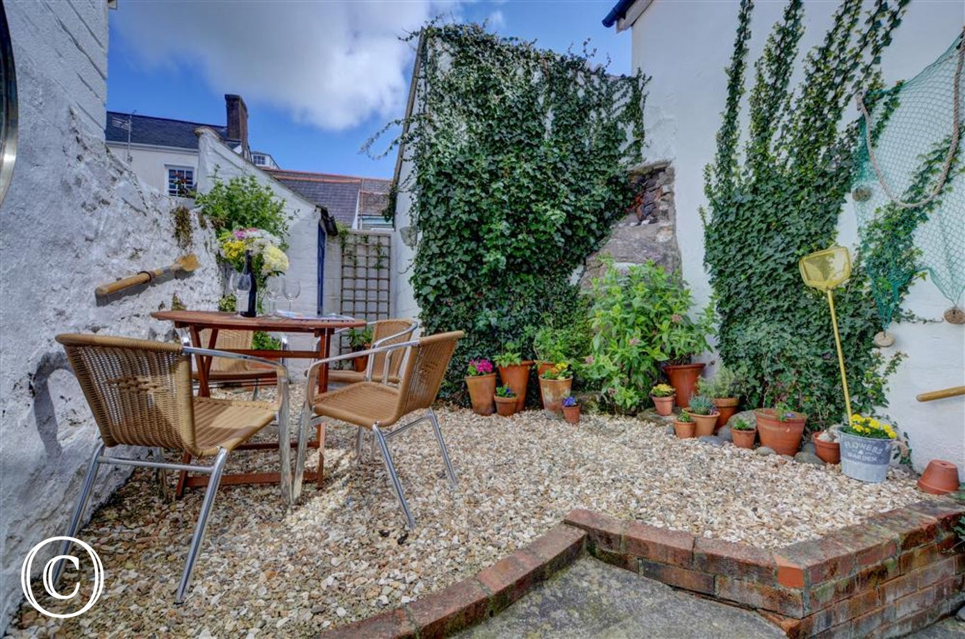 For relaxation and al fresco dining the cottage also offers a fully enclosed walled patio with garden furniture