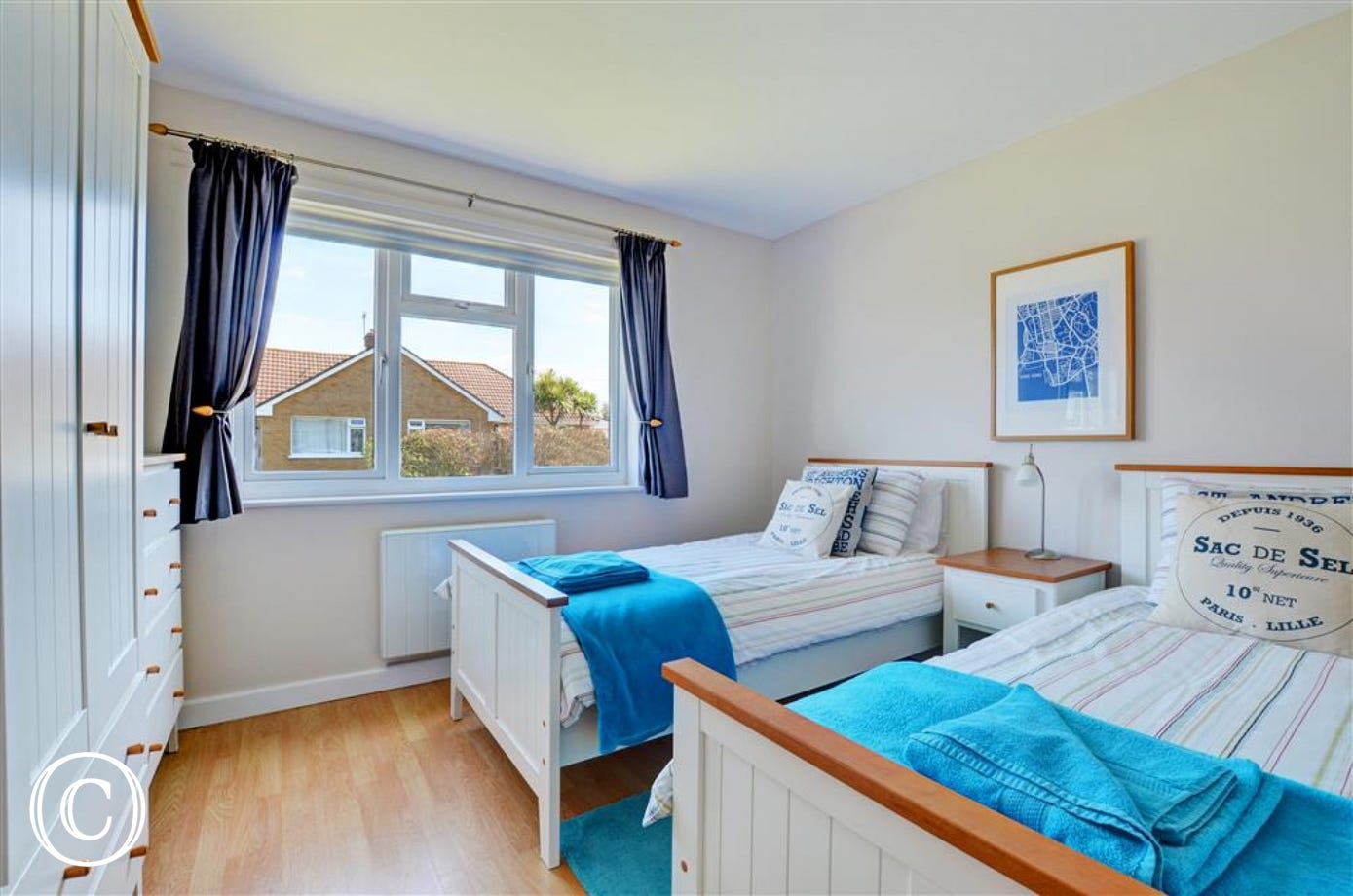 The twin room has a seaside feel