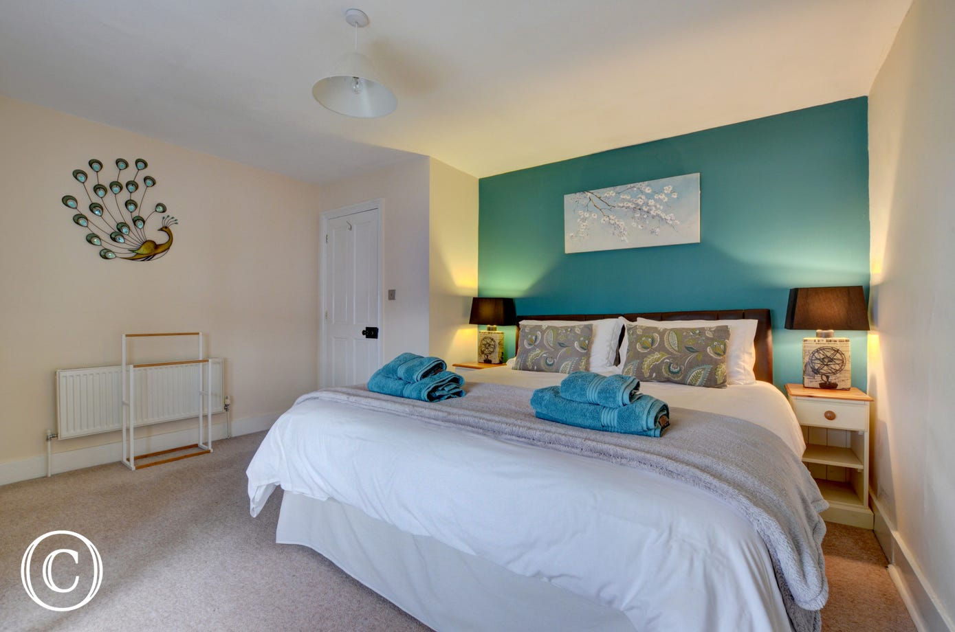 Luxurious superking size bed in the colourful master bedroom