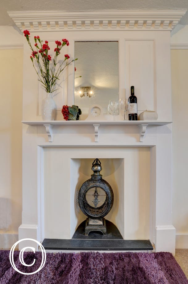 Ornate fireplace in the sitting room
