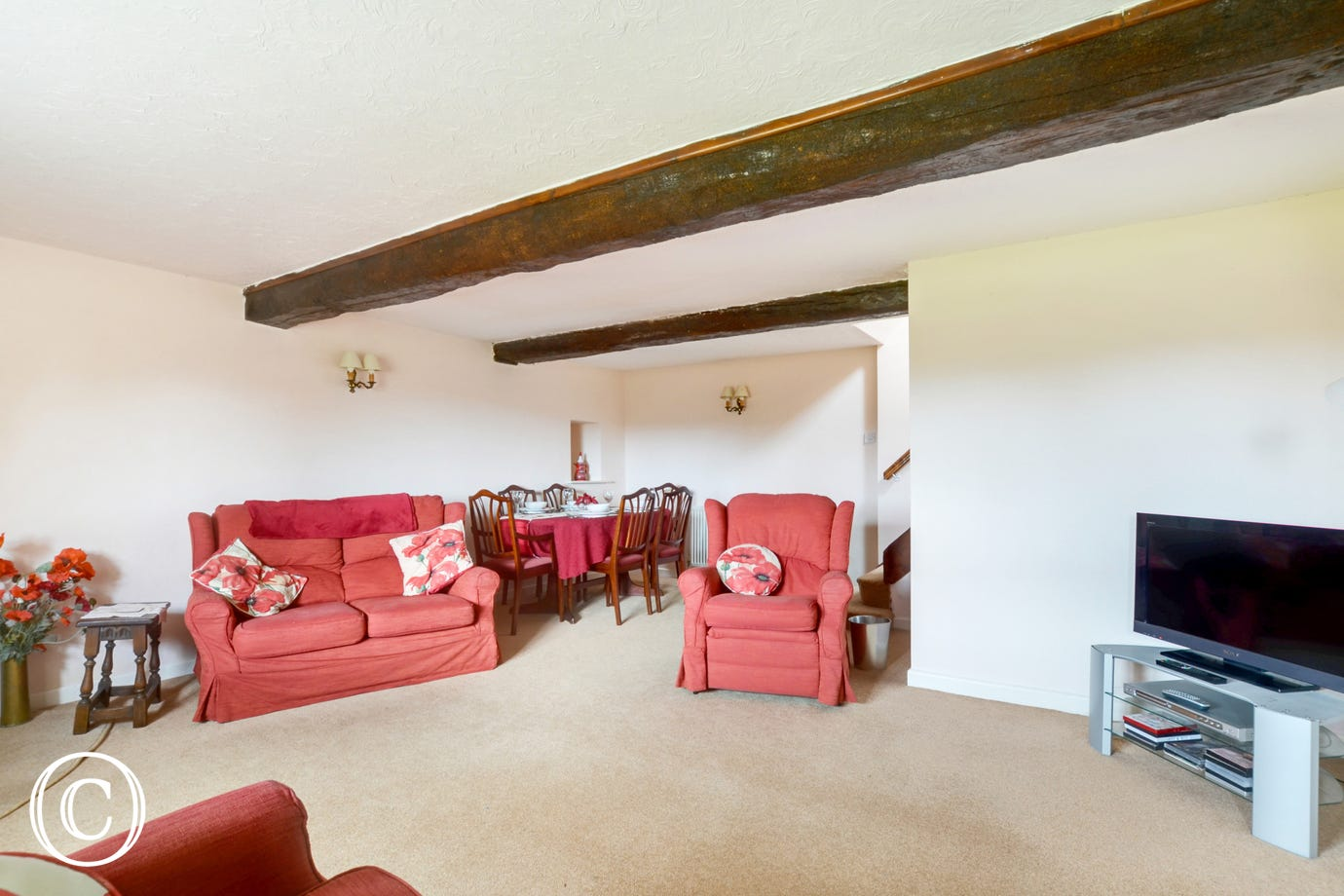 The sitting room has comfortable seating, large TV and cosy woodburning stove