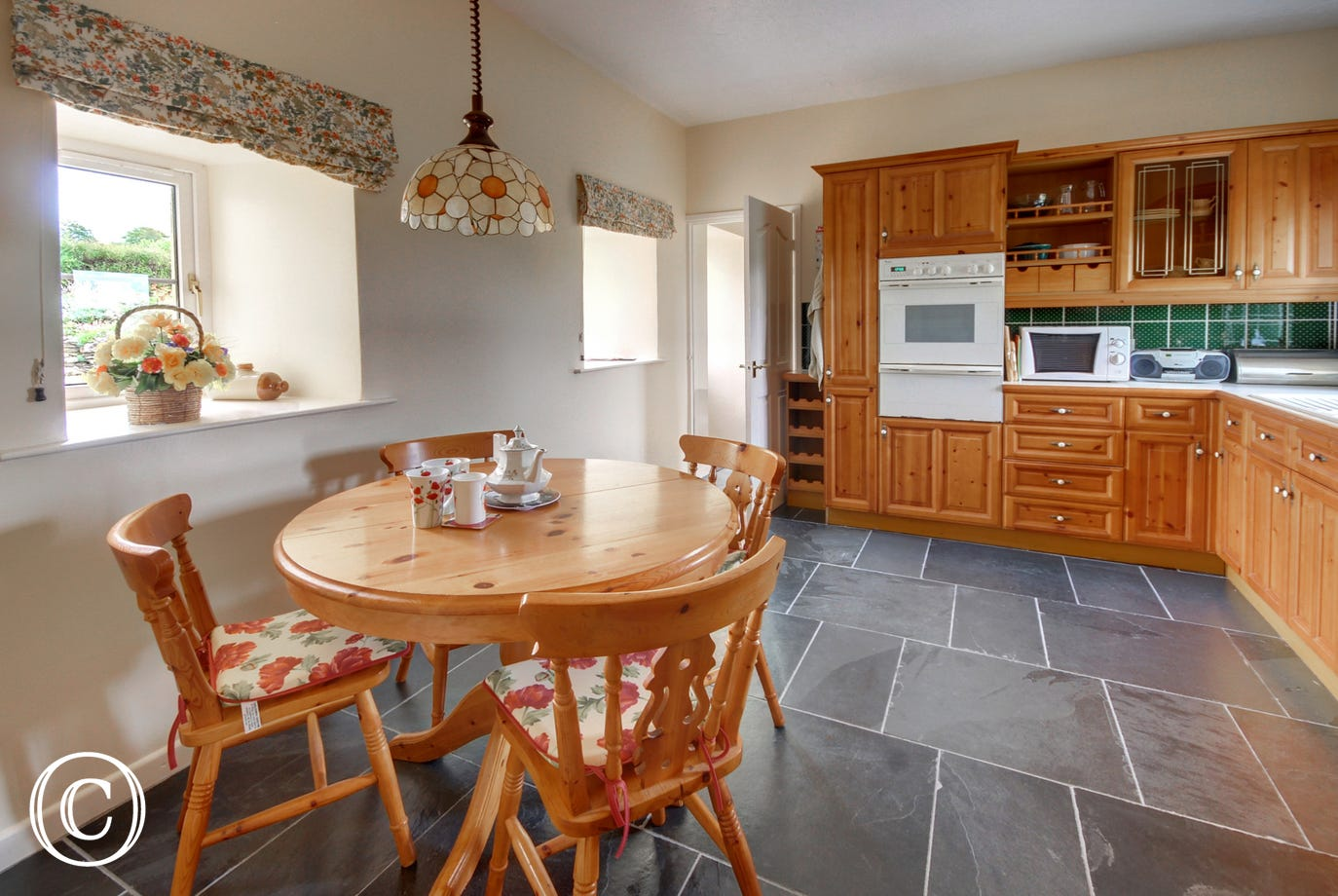 The attractive breakfast kitchen is extremely well equipped and a good size adjacent utility room is perfect for your coats and boots