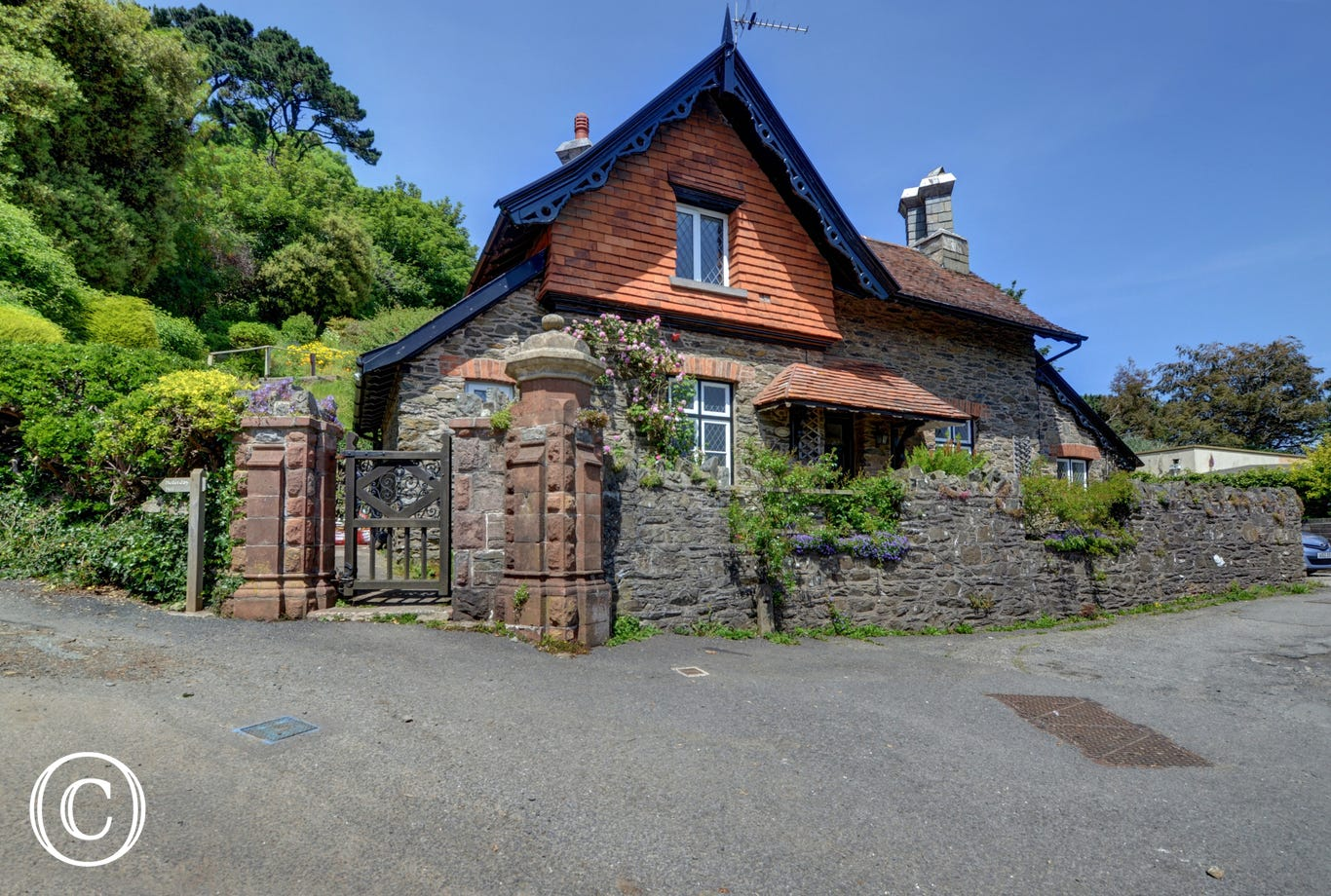Hollerday Cottage nestles on the hillside overlooking the delightful Exmoor coastal village of Lynton