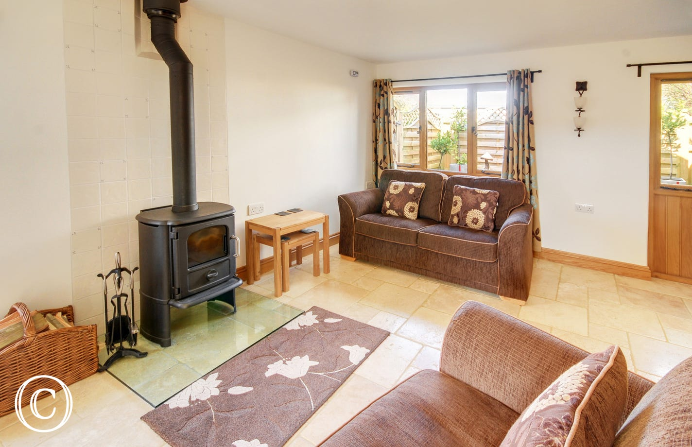 The stylish living room with comfy seating and wood burning stove