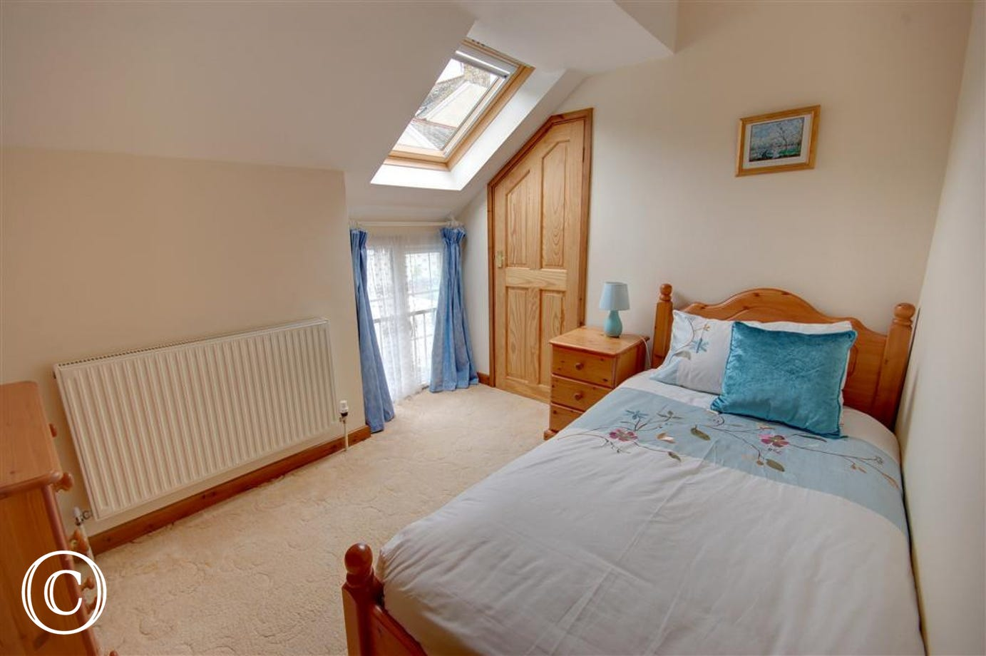 Spacious single bedded room with velux window for added light