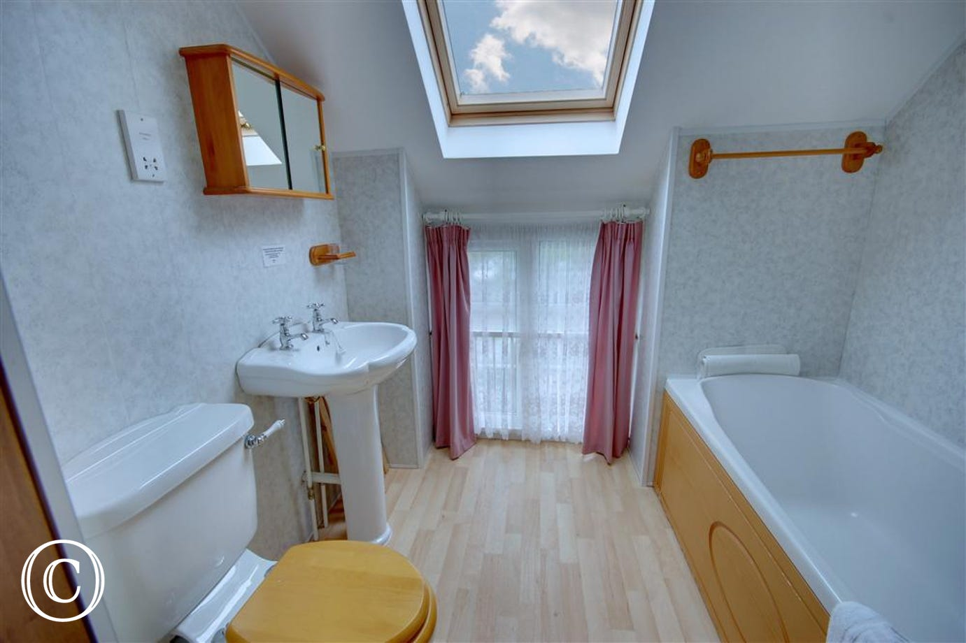 Lovely spacious family bathroom with shower attachment