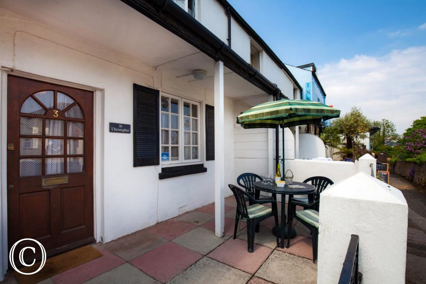 outside courtyard terrace area with seating for four guests in Shaldon