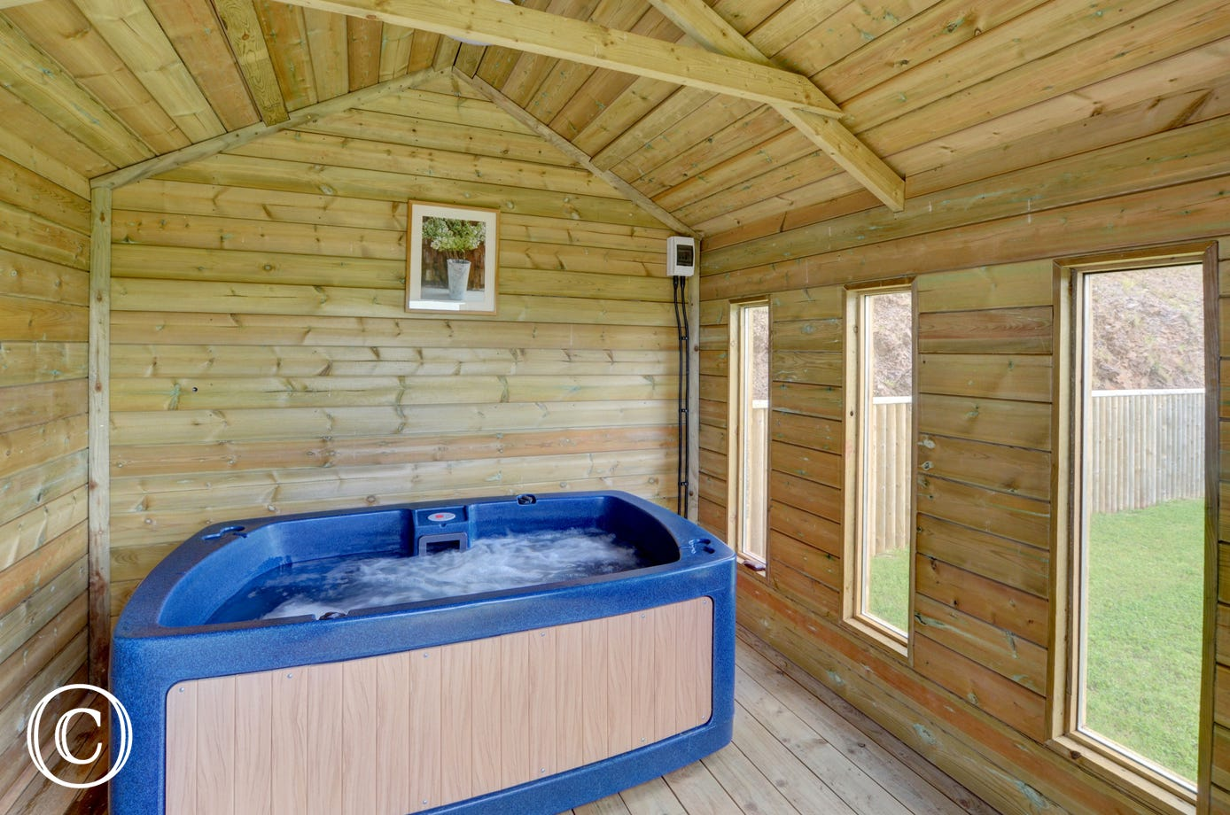 Your own private hot tub in an adjacent summerhouse to provide that extra special bit of luxury