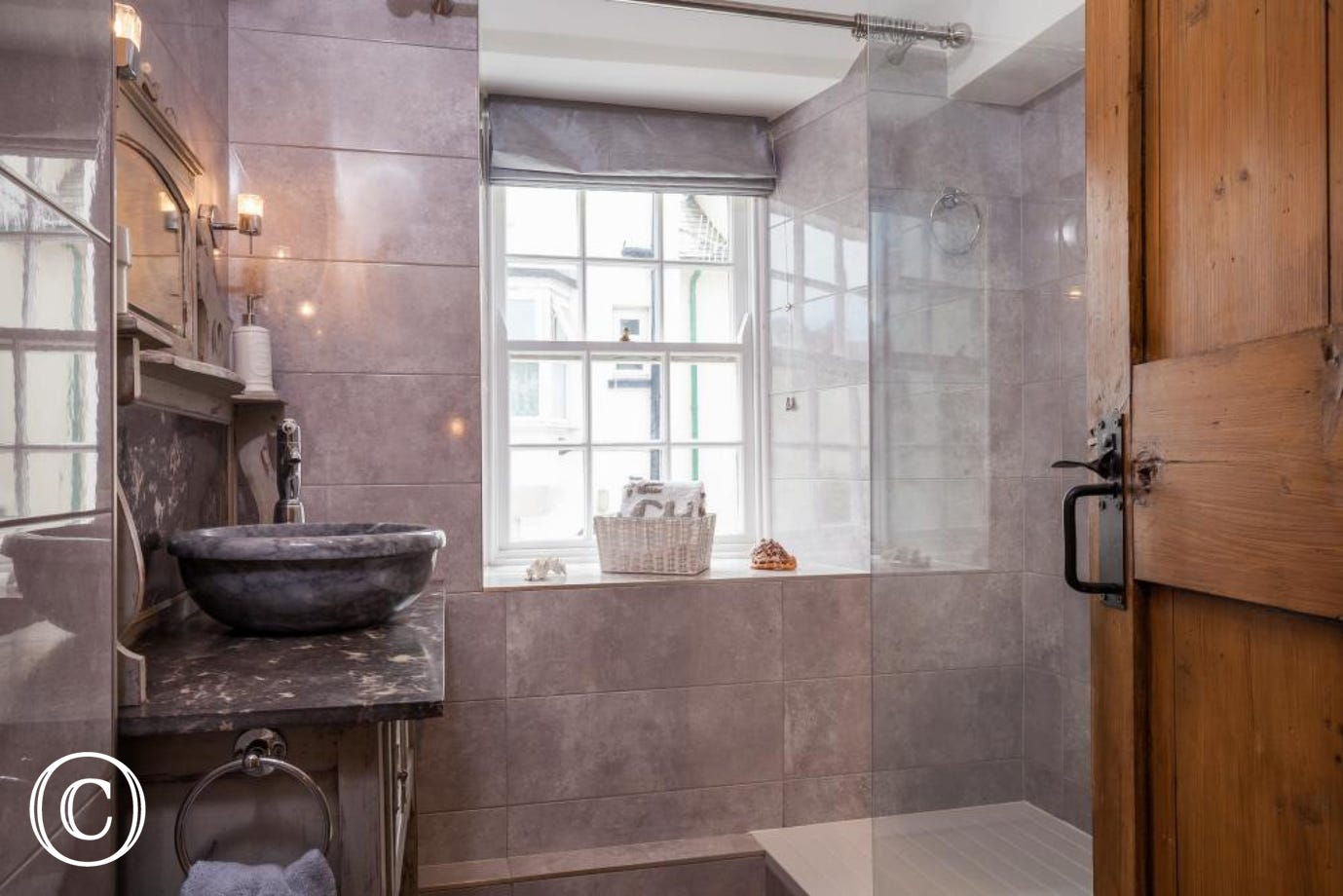Shower room with large shower with monsoon shower head on the first floor.