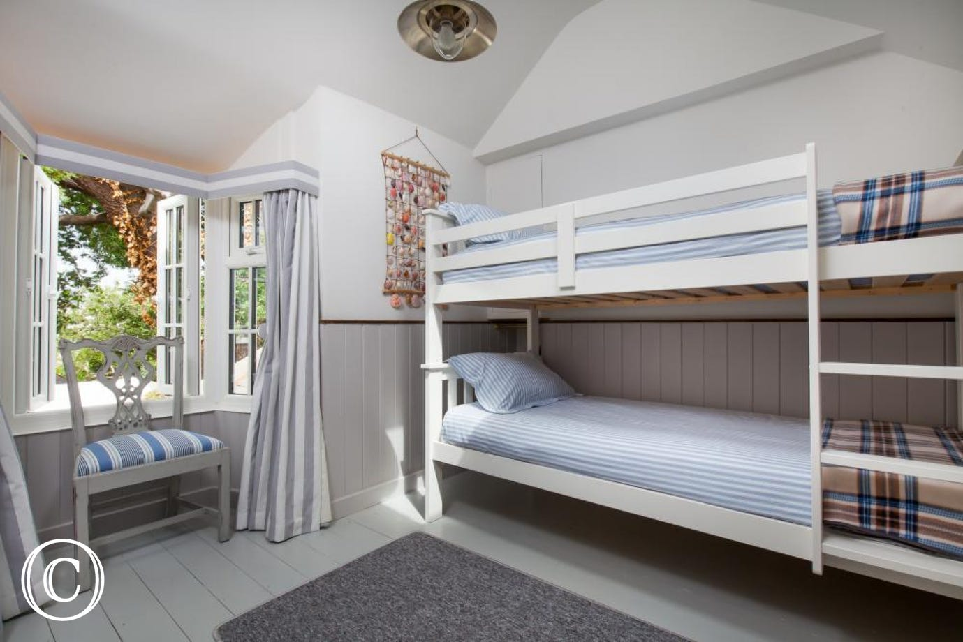 3rd bunk bed room (suitable for adults) with estuary views from the right window furnished with drawers & a TV