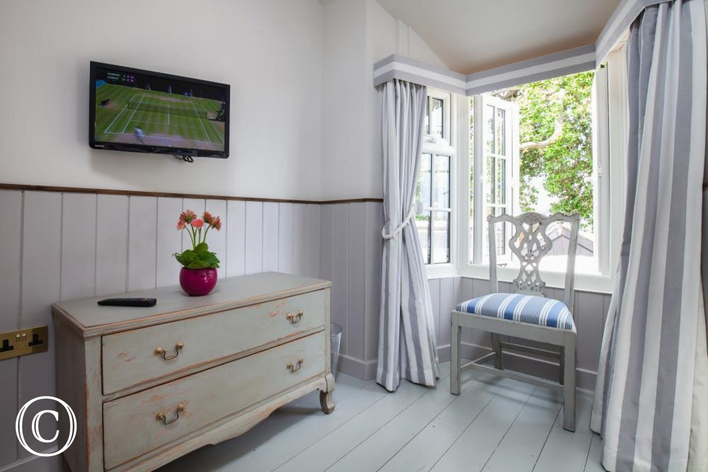 3rd bedroom TV, drawers and bay window with views to the estuary.