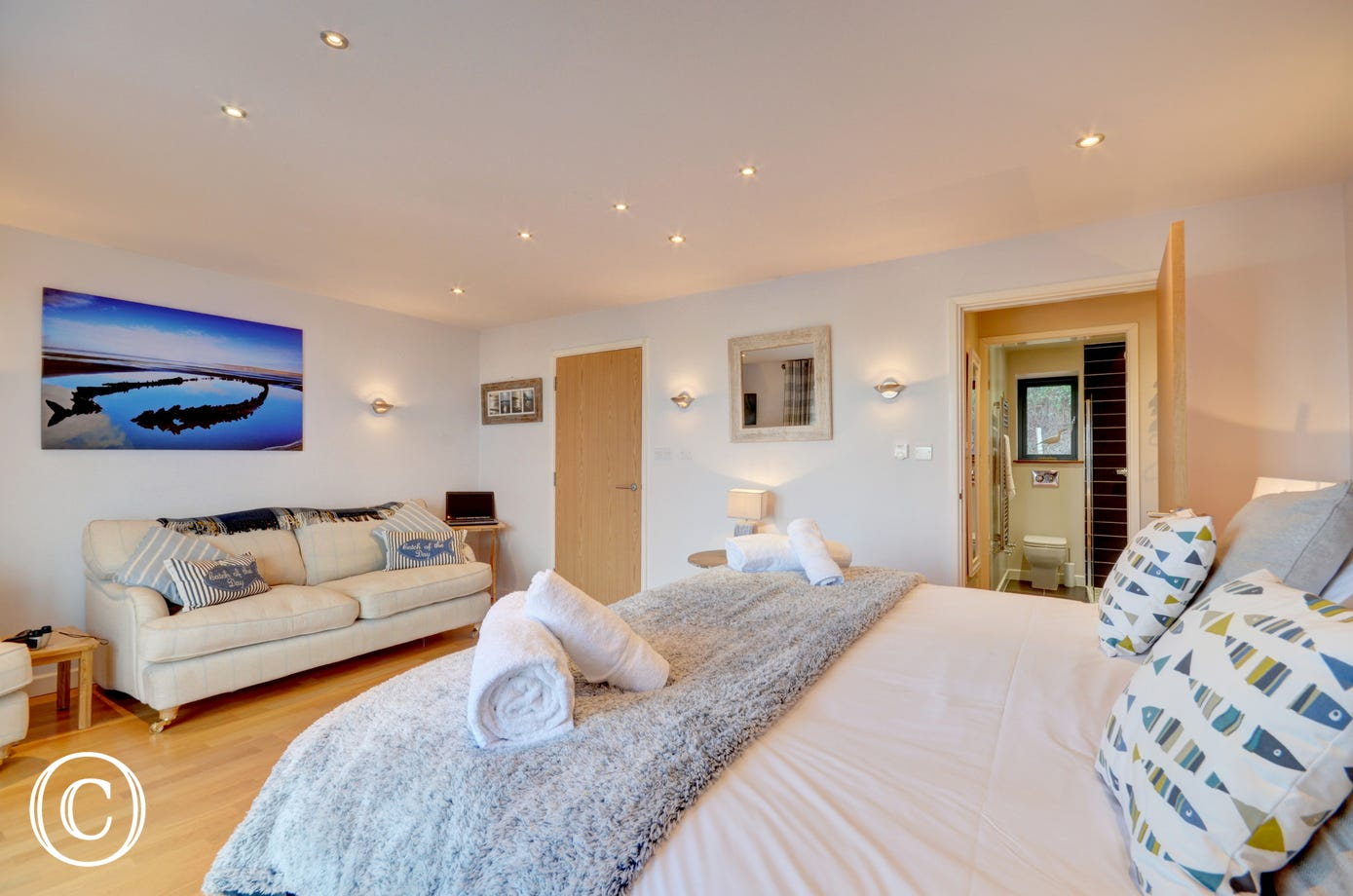 Master bedroom with dressing room, ensuite and comfortable sofas
